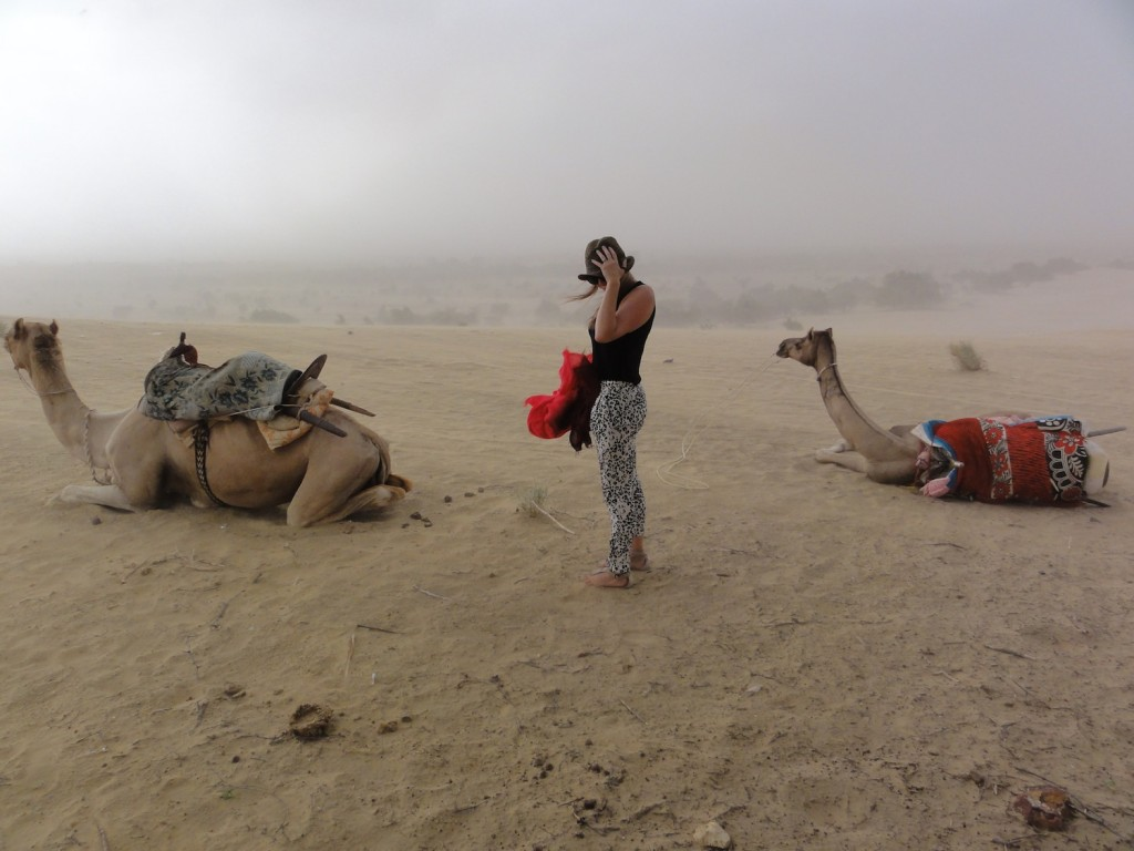 Heather braving the wind, and soon the rain, during our camel safari!