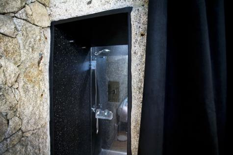 "The ""outside"" shower, built in to the wall, complete with magnificent views of the Dom Luis Bridge!"
