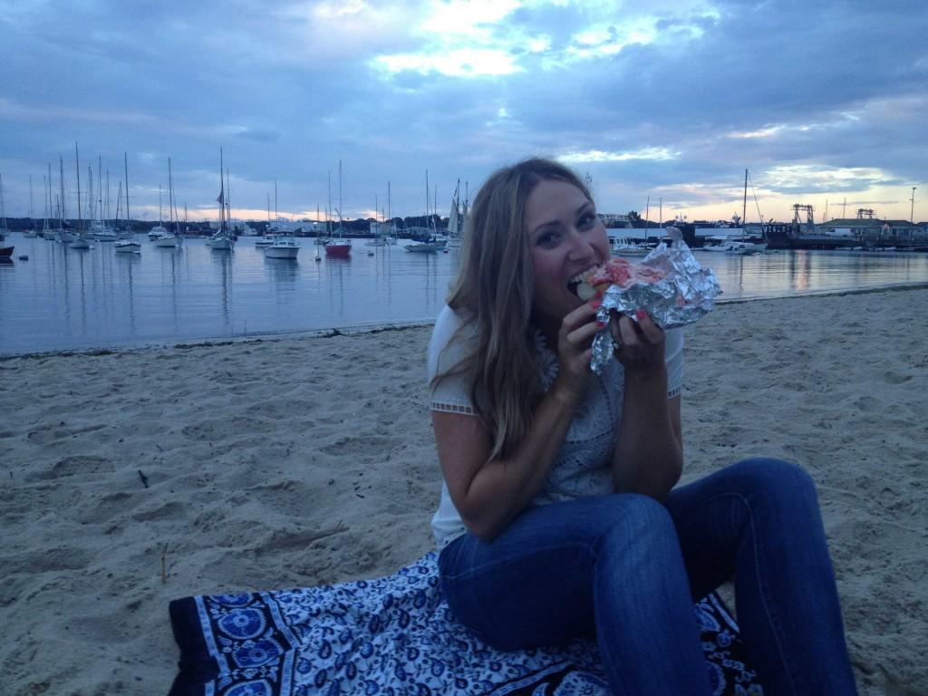 Quintessential Martha's Vineyard: Enjoying lobster rolls from Grace Church on the beach.